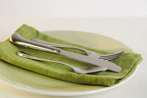 Close up of silverware and napkin on plate