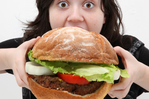 woman-eating-giant-burger
