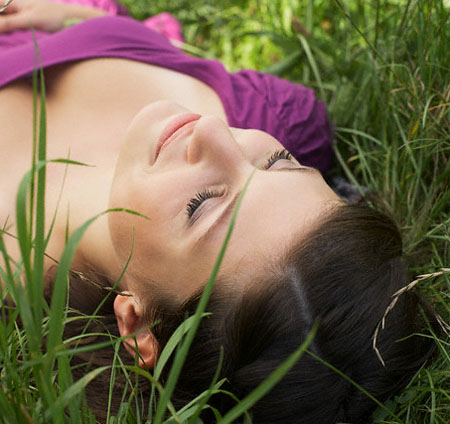 Woman napping in the grass
