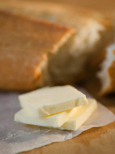Slices of butter and fresh bread, close-up