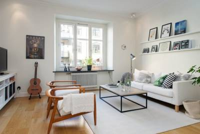 Scandinavian style interior design A small number of colors For accents it is used textile 909x606 400x267 - Интериорен дизайн в скандинавски стил за малкото жилище