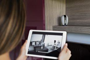 close up woman checking security camera 290x193 - Скрита камера у дома – ползи и принципи на действие
